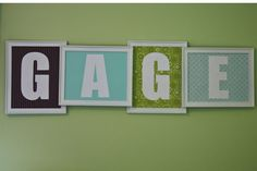 """""""I bought four frames from the dollar store. I then spray painted them white. Then I just added in paper from the scrapbook store and cut out letters out of white card stock that I glued onto each paper."""" - Poster"""