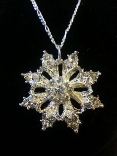 Check out this item in my Etsy shop https://www.etsy.com/listing/213246136/handmade-rhinestone-snowflake-necklace