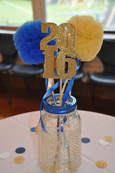 Graduation ceremony or high school reunion centerpiece tulle pom pom wands for centerpiece . Graduation or high school reunion centerpiece tulle pom pom wands for centerpiece – set of 12 basic School Reunion Decorations, Reunion Centerpieces, Graduation Table Decorations, Backyard Party Decorations, Graduation Party Decor, High School Graduation, Graduation Centerpiece, Graduation Ideas, Gold Centerpieces