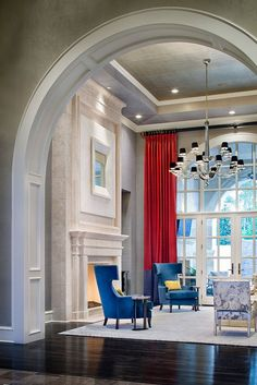 Gorgeous Donghia chandelier, bold paneled draperies and lounge chairs by Holly Hunt.