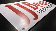 Vinyl banner with grommets ready to go for JJ Bean Coffee.
