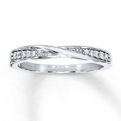 This wedding band for her features a twist of 10K white gold at the center with round diamonds ascending in size at each side. The ring has a total diamond weight of 1/15 carat. Diamond Total Carat Weight may range from .085 - .11 carats.