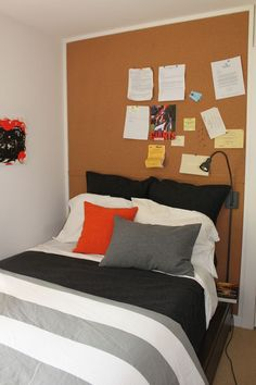 I LOVE the idea of a bulletin board as a headboard! Very inexpensive!