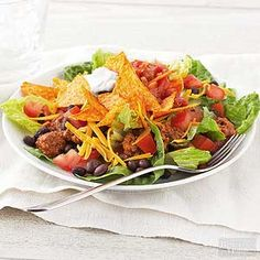 Top this salad with nacho tortilla chips for flavor and crunch. /