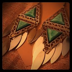 Gold Triangle Earrings Flashy gold dangling earrings with turquoise colored accent beads. Jewelry Earrings