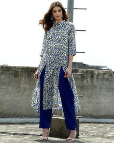 Shop Set of floral tunic with straight pants Salwar Designs, Blouse Designs, Pakistani Dresses, Indian Dresses, Indian Outfits, Indian Fashion Designers, Indian Designer Wear, Indian Attire, Indian Wear