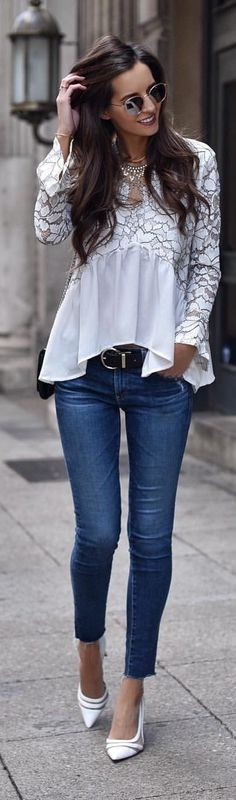 #spring #outfits woman wearing white long-sleeved blouse and blue denim jeans. Pic by @myviewinheels