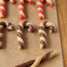 Candy Cane Cookies  Gently roll each color separately into ropes on a flat, lightly floured surface using the palm of your hand for best results. Brush off excess flour with a dry pastry brush before twisting the two colored ropes together. Chill 20 minutes before baking to help the cookies maintain their shape.