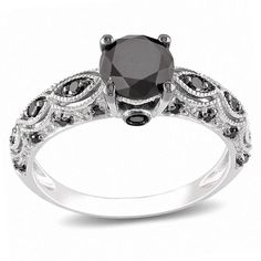 This Miadora ring features a round cut black diamond in a white gold setting, making it a fit for both elegant and casual settings. Its 24 round cut diamond side stones and a band measuring 2mm comple