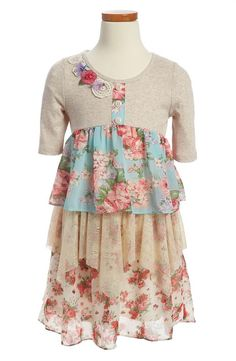 Tiers of charming floral print for your little one.