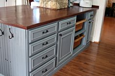 The counter top on this island cost her $36! She bought the pine and finished it herself. Also other neat ideas for remodeling your kitchen on a budget.