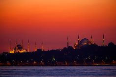 the blue mosque and hagia sophia against the sunset sky, istanbul, turkey