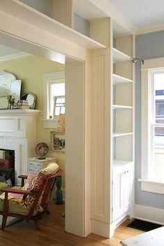 Bookcase surrounding a door