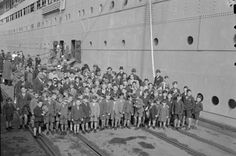 This image shows a group of post-war child migrants  arriving in Fremantle, Australia in 1947. In Ship of Haunts, Lucie and her cousin arrived in Australia in 1948.