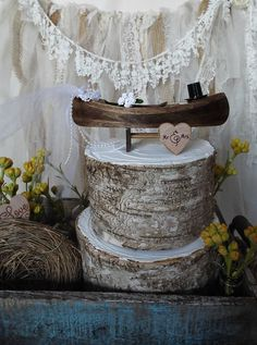 If your having a rustic,fishing,country or outdoors themed wedding,you will LOVE this country canoe wedding cake topper. If you are a fan of the movieThe Note Book like I am,than you can agree there is nothing more romantic than a canoe ride on a country lake. This wood canoe is stained in deep tobacco and measures 7.5 long x 2.5 wide. On either side sits the bride and grooms top hat and veil as well as her bouquet of roses.Roses also come in white,pale pink,mauve or lavender upon request…