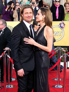 Loved the tux, hate the long hair and beard.  I miss the clean cut brad days.  Still nto blown away by Angelinas dress either.  B