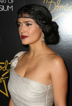 Brides.com: Wedding Beauty Inspired by The Great Gatsby. Salma Hayek's Flapper-Inspired Hairstyle. Her dress is Grecian, but her makeup and hair are all Roaring '20s. Hayek's crimson lips, gray eyeshadow and Art Deco earrings are trademarks of the era, while her updo and funky headpiece add a flapper-style twist. Try one of these looks to add a vintage edge to your wedding day look, or combine a few to channel some serious Gatsby glam.