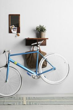 Bicycle storage for your small home or apartment | Laurel & Wolf interior design services | http://blog.laurelandwolf.com/bicycle-beauty-how-to-store-your-bike-in-style/
