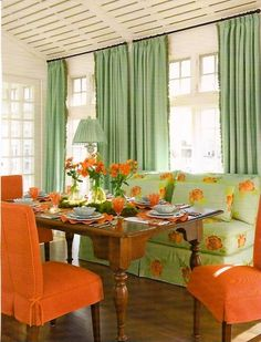 Love the orange and green. Always love a sofa to pull up to the table - especially in limited space