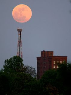 """The """"supermoon"""" rises over the Renkert Building, Saturday, May 5, 2012 in Canton, Ohio. The biggest and brightest full moon of the year arrives Saturday night, May 5 as our celestial neighbor passes closer to Earth than usual. Love moon scenes!!"""