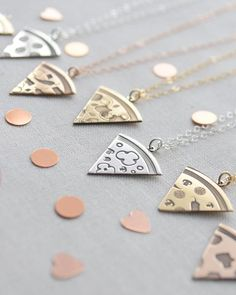 Pizza Necklace by Olive Yew. We're so excited to be able to offer the first custom pizza slice necklace. Choose up to three toppings along with the finish of your choice and we'll make it fresh for you. These also make perfect best friend gifts!