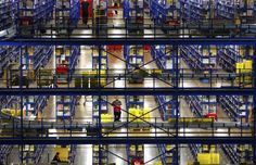 File picture of a worker walking through the picking tower at the Amazon warehouse in Milton Keynes