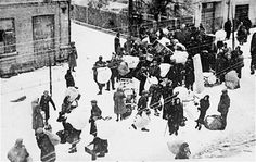 Jews being forced into the new Grodno Ghetto in Bezirk Bialystok (now, Belarus) in November 1941
