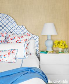 If you're too scared to go all out with florals, use them as an accent, like on your pillows. In the bedroom of a New York City apartment, designer Ashley Whittaker mixes florals and solid whites.   - HouseBeautiful.com
