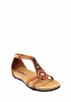 The Minnetonka Bayshore in Saddle. The multicolored beadwork with a super soft footbed and side and back heel straps mean you can walk for miles in sophisticated style. #MinnetonkaFirstLook #sneakpeek #sandals
