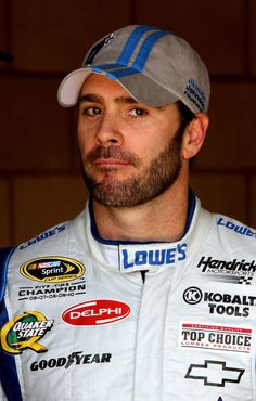 Jimmie Johnson, driver of the #48 Lowe's/Jimmie Johnson Foundation Chevrolet, stands in the garage during practice for the NASCAR Sprint Cup Series Auto Club 400 at Auto Club Speedway on March 23, 2012 in Fontana, California.