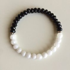 Genuine Round Moonstone & Faceted Black Onyx Bracelet w/ Swarovski Crystal Spacers  ~ 6mm Beads by PeaceOfMindInc on Etsy https://www.etsy.com/listing/210841637/genuine-round-moonstone-faceted-black