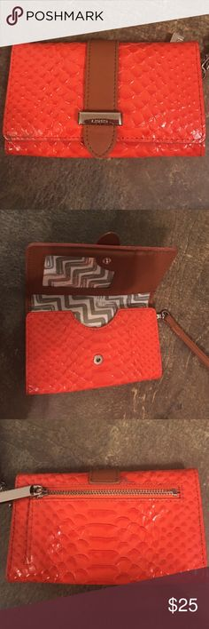 Lodis phone wristlet Orange and brown Lodis wristlet. Lightly used. Slight scratches on hardware.  Will fit iPhone 6 or smaller phones. Lodis Bags Clutches & Wristlets