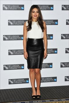 I love this black leather pencil skirt as worn here by Mila Kunis. It's sexy but not outrageous. I want one.