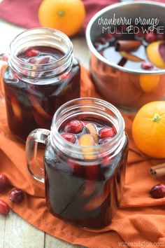 Cranberry Orange Mulled Wine | Cranberry orange mulled wine is a nice way to bring on the festivities. This is a spiced, tart drink for the adults at the table. So flavorful! @wineandglue