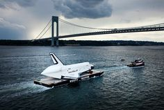 || Space Shuttle Enterprise is carried by barge underneath the Verrazano-Narrows Bridge on June 3, in New York City. Enterprise is on its way to the Intrepid Sea, Air and Space Museum, where it will put on permanent display.