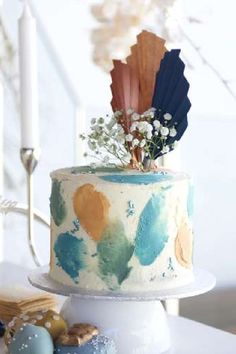 Take a look at this magical boho rainbow baby shower! The cake is wonderful! See more party ideas and share yours at CatchMyParty.com #catchmyparty #partyideas #rainbowbabyshower #rainbowparty #bohoparty #babyshower #cake