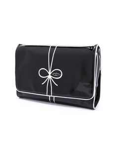 This darling bow case by Jonathan Adler is ideal for traveling.