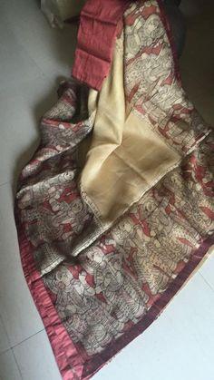 Off White Kota Silk Saree with pen kalamkari story border and Raw silk patti all around the saree and paired with a raw silk blouse.