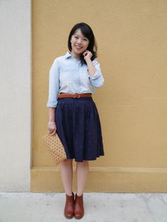 Vancouver blogger Lisa Wong of Solo Lisa wears a Madewell chambray shirt and cognac leather booties, J. Crew cognac leather belt and polka d...