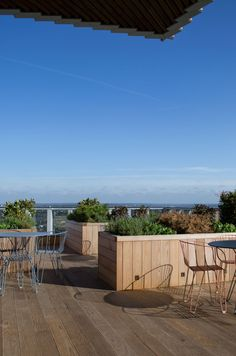 The view across London from the Sky Garden with its raised wood planters at The Stratford.