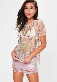 A mesh top with white hue, floral embroidered detail and oversized fit.