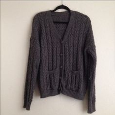 Grandpa Cardigan Has been used once. Very thick. Color is odd it is like a gray/Brown. Has pockets in the front. No trades. Price is somewhat negotiable make an offer thru the button. Brandy Melville Sweaters Cardigans