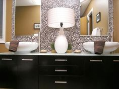 This busy wallpaper calls for nothing more than two simple  mirrors positioned above the sinks.