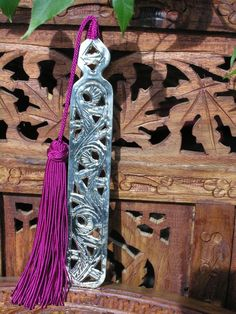 Moroccan metal book marks with pink silk tassel. http://www.maroque.co.uk/showitem.aspx?id=ENT06315&p=01571&n=all