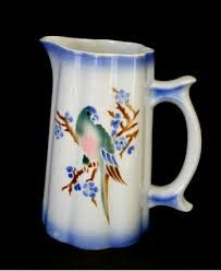 Papukaija (Parrot) pitcher. It's the most expensive item of Arabia if it's in mint condition.