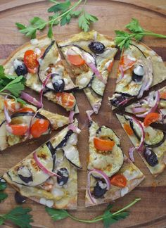 roasted eggplant and hummus pizza with creamy tahini sauce for a healthy and light pizza. It's vegan too!