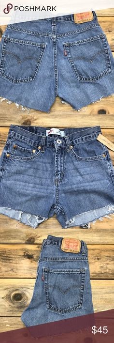 """Levi's 550 high waisted denim shorts 26w Levis 550 medium wash denim cut off shorts.  Vintage and sold as is. They run 1-2 sizes smaller than regular denim shorts so I recommend to buy at least one size larger. Its best to know your waist and hips measurements to ensure shorts that fit. If they do not fit, no exchanges. All sales are final, no exchanges or returns as per policy, no trades. Please do not use my photos without my permission. Price firm. 34"""" hips 10"""" rise Levi's Shorts Jean…"""
