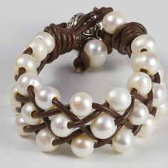 Love this bulky pearl and leather bracelet.