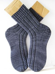 Asymmetrical cable socks. New pattern on rav. I really love the rope braid cable.