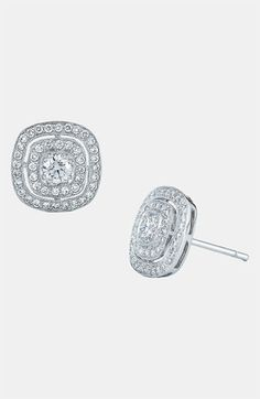 Kwiat 'Silhouette' Diamond Stud Earrings   Round Brilliant Diamonds bring fiery sparkle to the center of pavé-traced stud Earrings handcrafted in 18K White Gold.  Post back.  Total carat weight: 0.80ct.  Color: G-H. Clarity: VS1-VS2.